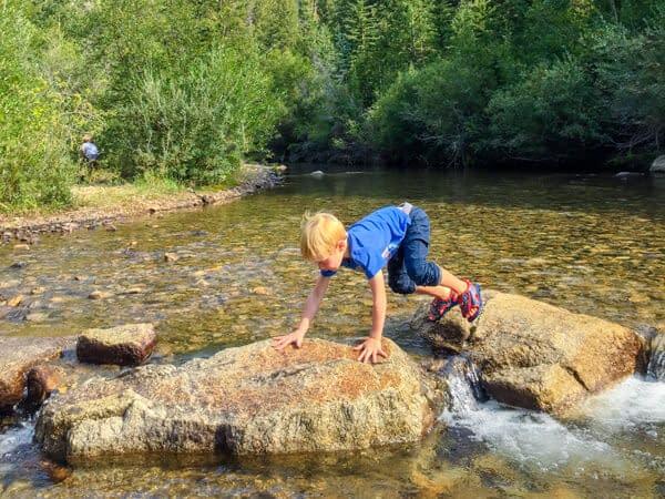 boy playing in Colorado creek