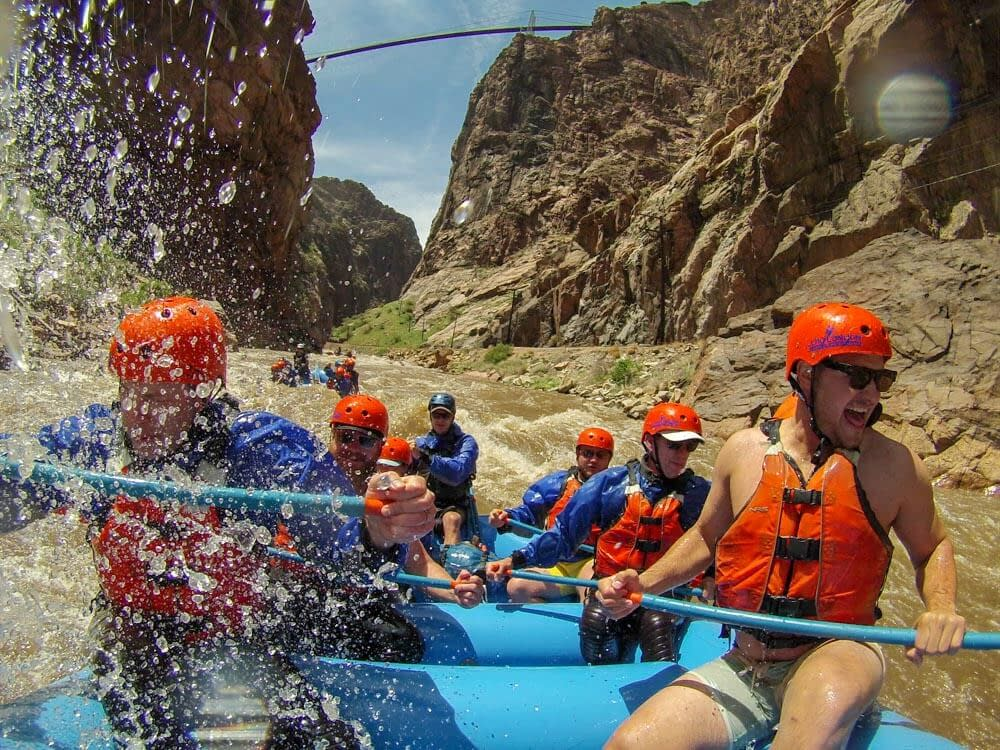 raft under the Royal Gorge Bridge on class IV rapids