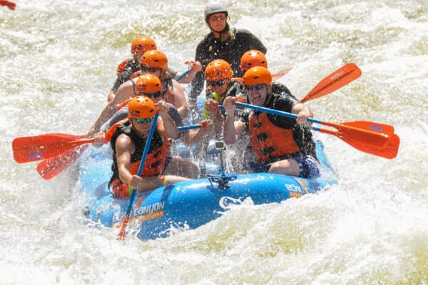 Paddling through a class III rapid