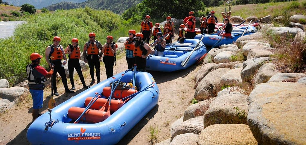 Guides and rafting guests preparing for a raft trip