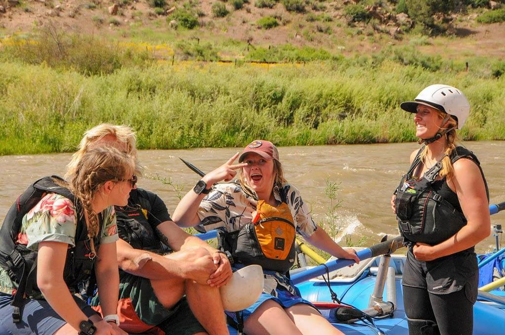 guides joking around at river put-in